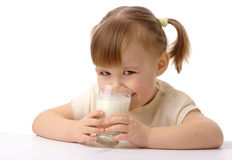 Little girl drinks milk Stock Images