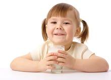 Little girl drinks milk. Cute little girl drinks milk, isolated over white Stock Photo