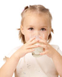 Little girl drinks milk. Cute little girl drinks milk, isolated over white Stock Image