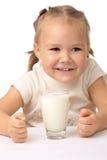 Little girl drinks milk. Cute little girl drinks milk, isolated over white Royalty Free Stock Image
