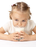 Little girl drinks milk. Cute little girl drinks milk, isolated over white Stock Photos