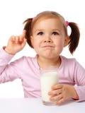 Little girl drinks milk Stock Photos
