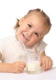Little girl drinks milk using drinking straw. Cute little girl drinks milk using drinking straw, isolated over white Stock Image