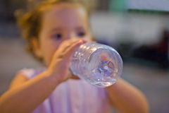 Little girl drinks Stock Photos