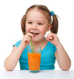 Little girl drinks orange juice Stock Photo