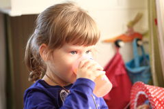 Little girl drinks. From a plastic cup Stock Image