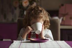 Little girl drinks tea Royalty Free Stock Photo