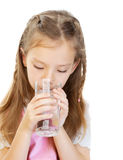 Little girl drinks water Royalty Free Stock Photography