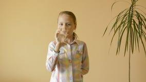 Little girl drinks water stock video