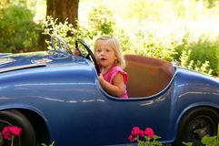 Little girl in oldtimer. Little girl drive a toy oldtimer Royalty Free Stock Photography