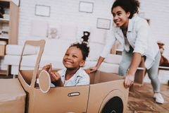 Little Girl Drive with Young Mother Like a Car. Mother and Young Girl Drive with Mother. People Play with Car. Little Girl Drive Car. Young People and Car royalty free stock image