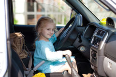 Little girl driving a car Stock Photography