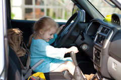 Little girl driving a car Stock Images
