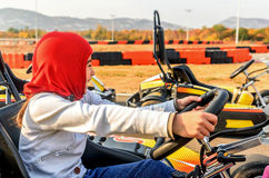 Little girl is driving Go- Kart car in a playground racing track Royalty Free Stock Photos