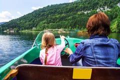 Little girl driving rental boat Stock Photos