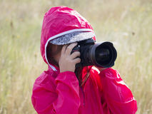 Little girl with DSLR Stock Image