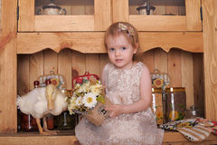 Little girl with duckling Stock Image