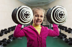 Little girl with dumb-bells Stock Photo