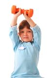Little girl with dumbbell Royalty Free Stock Photos