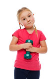 Little girl with dumbbell. Royalty Free Stock Image