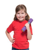 Little girl with dumbbell Stock Image