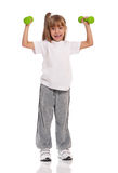 Little girl with dumbbells Stock Photos