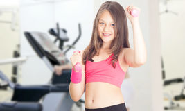 Little girl with dumbbells Royalty Free Stock Image