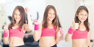 Little girl with dumbbells Stock Photography
