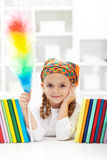 Little girl dusting in her room Royalty Free Stock Images