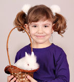 Little girl with dwarf white bunn Stock Photos