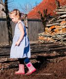 Little girl in early spring in the village.  royalty free stock photography