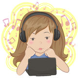 Little girl with earphones. Little girl at a laptop listening to music with earphones Stock Photography