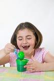 Little Girl at Easter. Little Girl Coloring Easter Eggs Stock Images