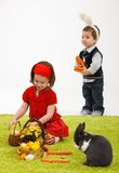 Little girl with Easter bunny Stock Image