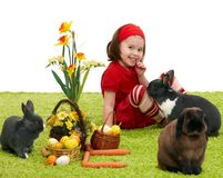 Little girl with Easter bunny Stock Photos