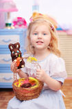 Little girl with easter bunny. Indoor Royalty Free Stock Photography
