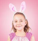 Little girl in Easter bunny ears smiles Royalty Free Stock Images