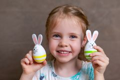 Little girl easter bunny eggs stock images