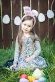 Little girl Easter celebration. Laughing children at Easter egg hunt stock photo