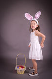 Little girl with Easter egg basket Stock Image