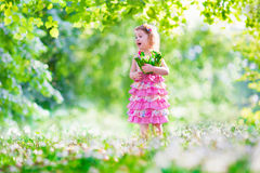 Little girl at Easter egg hunt Stock Images
