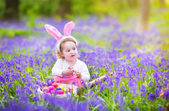 Little girl at easter egg hunt Stock Images