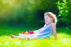 Little girl on Easter egg hunt Stock Image