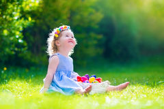 Little girl on Easter egg hunt Royalty Free Stock Photos