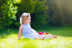 Little girl on Easter egg hunt Stock Photography
