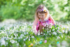 Little girl on Easter egg hunt Royalty Free Stock Photography