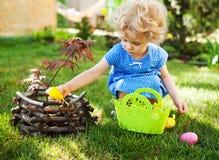 Little Girl on an Easter Egg hunt Stock Photography