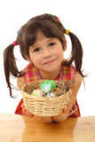 Little girl with easter eggs. In basket Stock Images