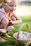 Little girl with Easter eggs. Adorable little girl holding a basket with Easter eggs outdoors on spring day Royalty Free Stock Images