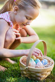 Little girl with Easter eggs. Adorable little girl holding a basket with Easter eggs outdoors on spring day Royalty Free Stock Photography